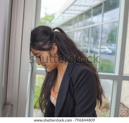 Stressful businesswoman put her on wall. Failure concept