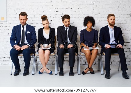 Stressful young business people waiting for job interview