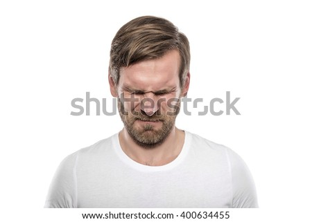 Stressful young man isolated on white background. - stock photo