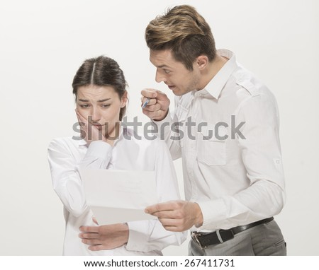 Stressful young women made a mistake at work, Businessman pointing at her as if accusing, isolated on white - stock photo