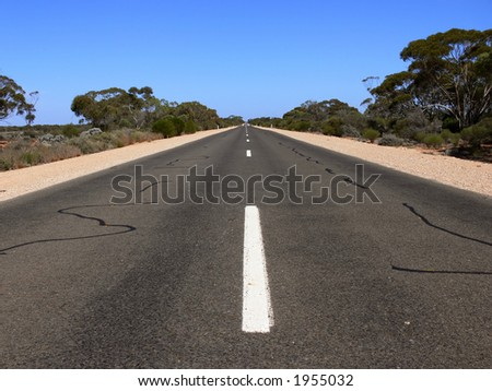 Stretch of country road - stock photo