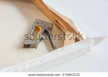 Stretched canvas and the staple - stock photo
