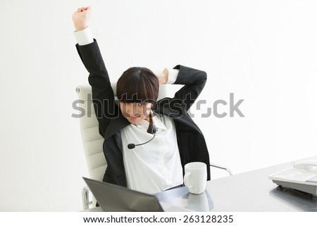 Stretching during a coffee break in the office  - stock photo