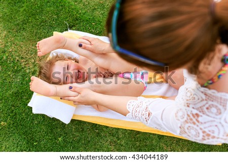 Stretching for baby - stock photo