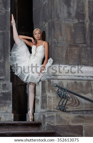 Stretching is everything. Vertical shot of a young ballerina stretching outdoors - stock photo