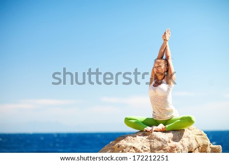 stretching on the mountains - stock photo