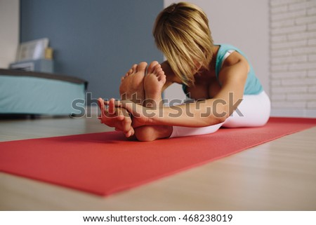 stretching pilate exercises in fitness studio. soft focus on hand