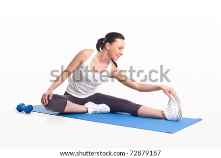 Stretching thin woman - stock photo