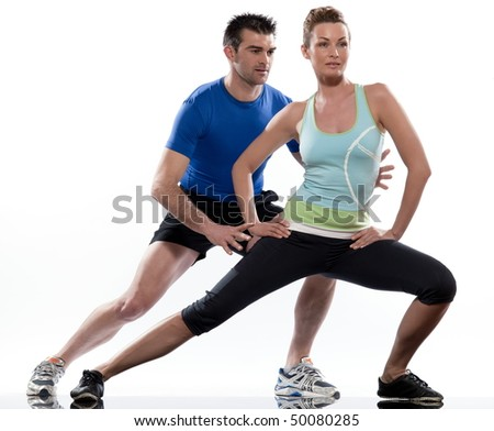 stretching workout posture by a couple, a man and a woman on studio white background - stock photo