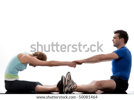 stretching workout posture by a couple a man and a woman on studio white background - stock photo