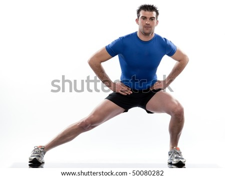 stretching workout posture by a man on studio white background - stock photo