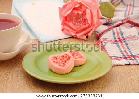 Strew berry heart cookies  on green plate    - stock photo