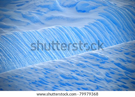 striated lines in blue ice on a glacier