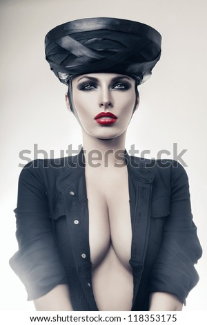 strict imperious woman in black with red lips - stock photo