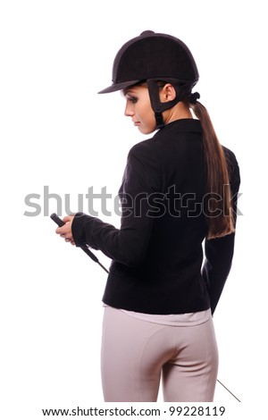 strict jockey with thin switch, isolated on white - stock photo