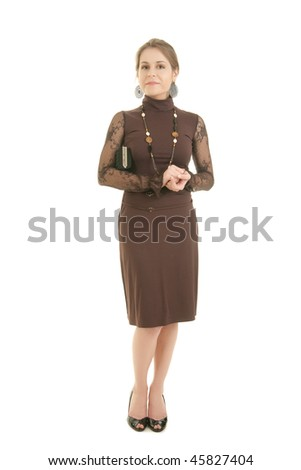 Strict serious fashion woman in brown dress