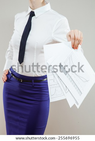 Strict unrecognizable businesswoman holding documents carelessy , neutral background - stock photo