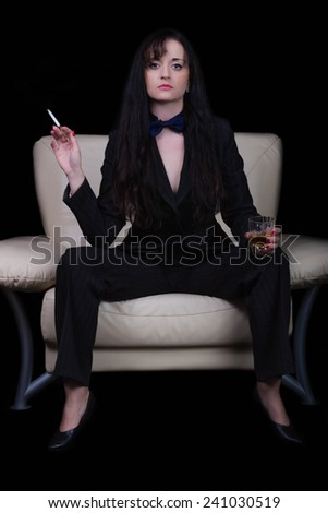 strict woman sitting on a chair and smoking a cigarette