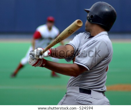 strike one, baseball batter swinging and missing - stock photo