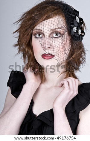 Striking Portrait of a Beautiful Red Headed Teenage Girl in Veil - stock photo