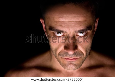 Striking portrait of a male with piercing expressive eyes - stock photo