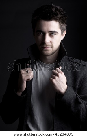 Striking Portrait Shot of a Handsome Dark Haired Male with Goatee Beard - stock photo