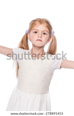 Striking pose young girl looking straight at camera in studio on white background. - stock photo
