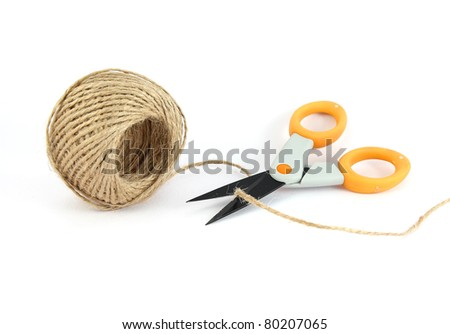 string and scissor on white background
