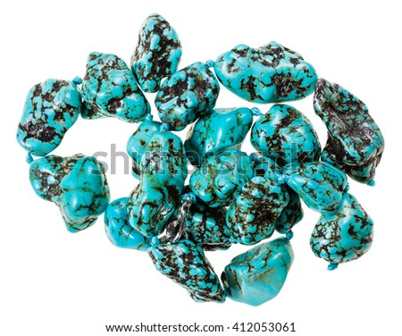 string of beads from natural mineral gemstones - blue Howlite (turquenite, Turquonite, turquoise imitation) stones isolated on white background - stock photo