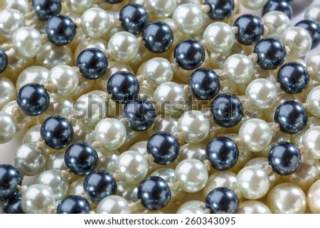 String of black and white pearls closeup - stock photo