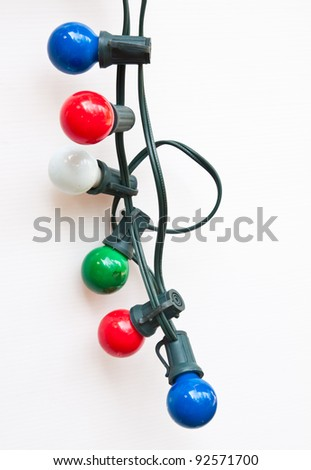 String of Christmas lights isolated on white background
