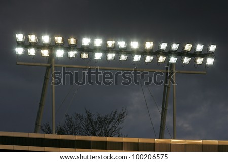 string of lights turned on and a cloudy sky in the background - stock photo