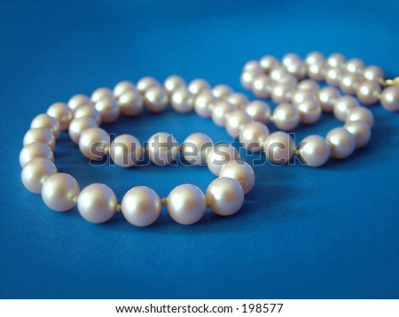 String of pearls on dark blue background