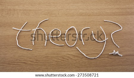 String Theory ...? Fun sign for science and quantum physics - theory of everything? For science, education and physics lessons. - stock photo