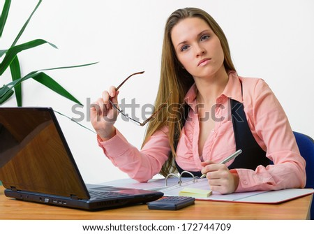 Stringent look / Beautiful young office worker looking stringent - stock photo