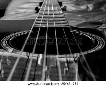Strings of a black guitar - stock photo