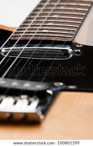strings on an electric guitar closeup