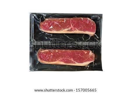 strip loin steak in plastic wrap - stock photo