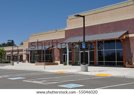 Strip Mall Shopping Center Parking Lot - stock photo