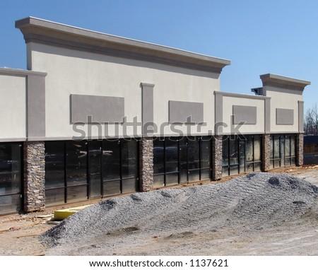 Strip shopping center under construction - stock photo