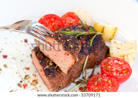 strip steak with cherry tomatoes - stock photo