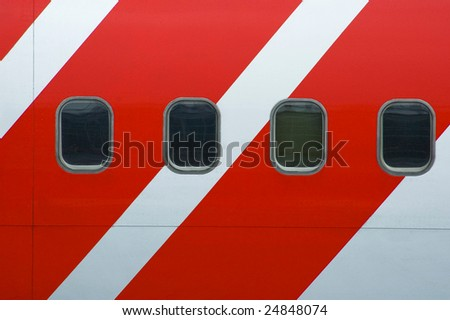 striped airplane - stock photo