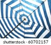 Striped beach umbrella - stock photo