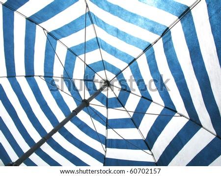 Striped beach umbrella - stock photo