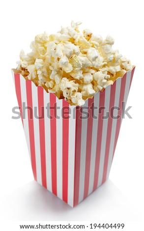 Striped box of fresh popcorn isolated on white background - stock photo