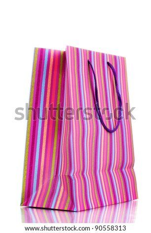 Striped gift bag isolated on white - stock photo