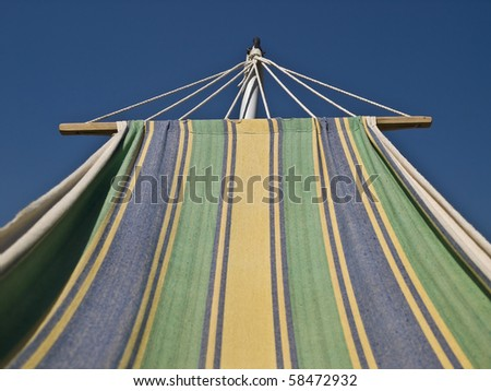 Striped hammock watching the blue sky during a summer day - stock photo