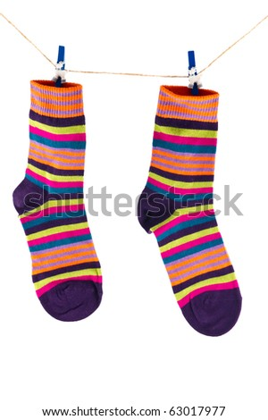 striped knit socks hanging on a rope - stock photo