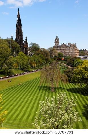 Striped lawn of Princess Gardens and Walter Scotts monument. Edinburgh. Scotland. UK. - stock photo