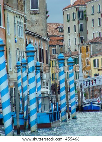 Striped moore poles in Venice, Italy - stock photo